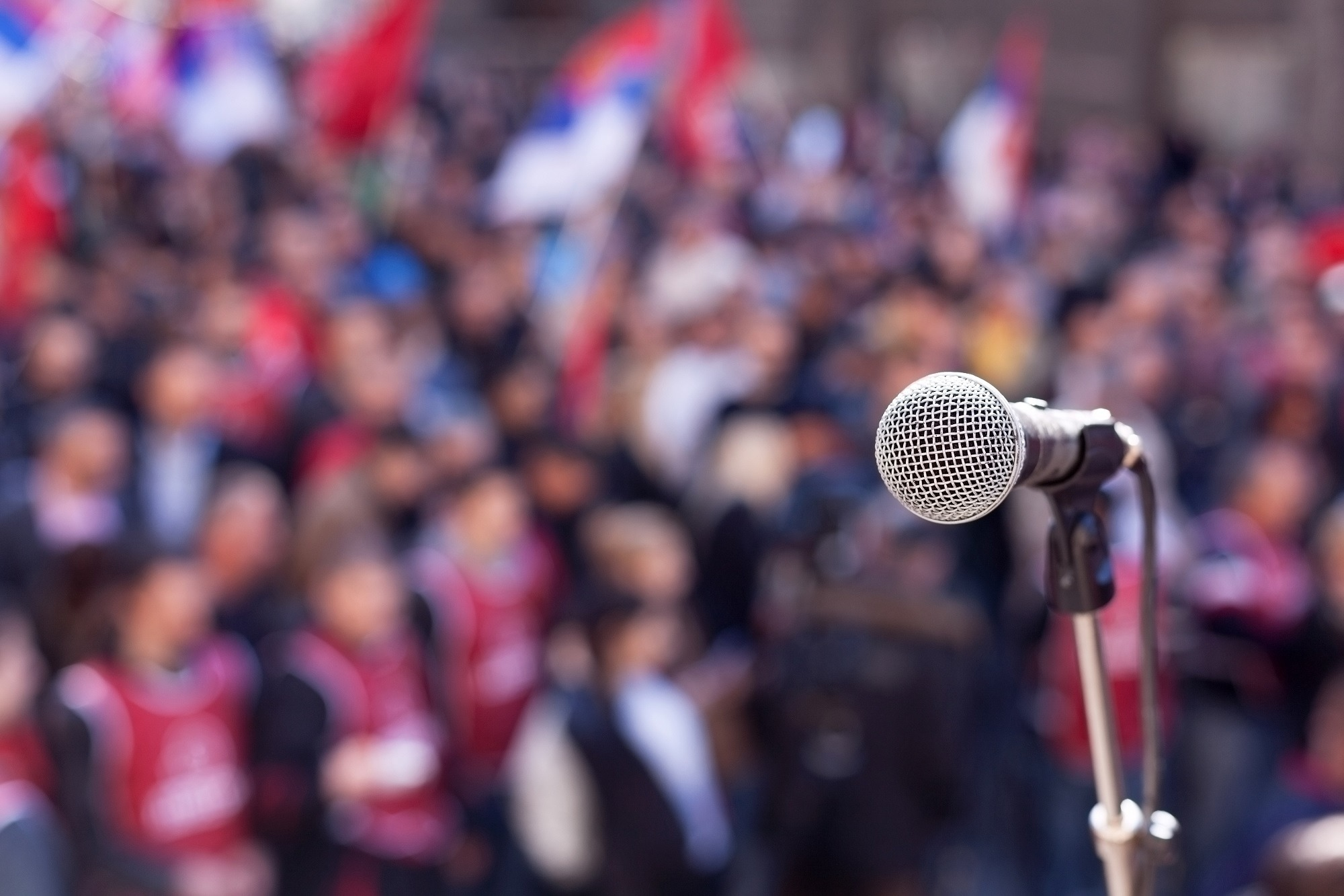 Microphone focused in front of a crowd