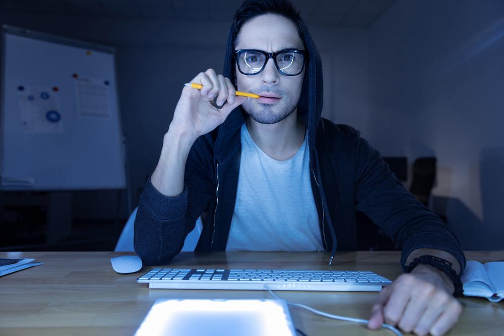 Hacker sitting at a computer
