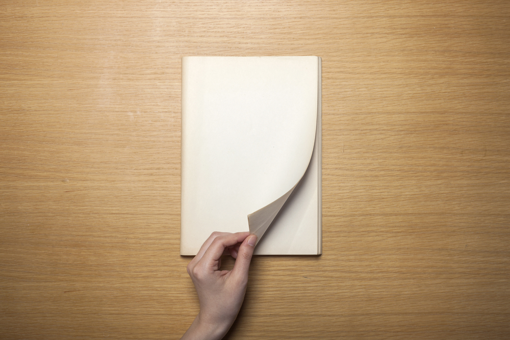 Turning pages of book